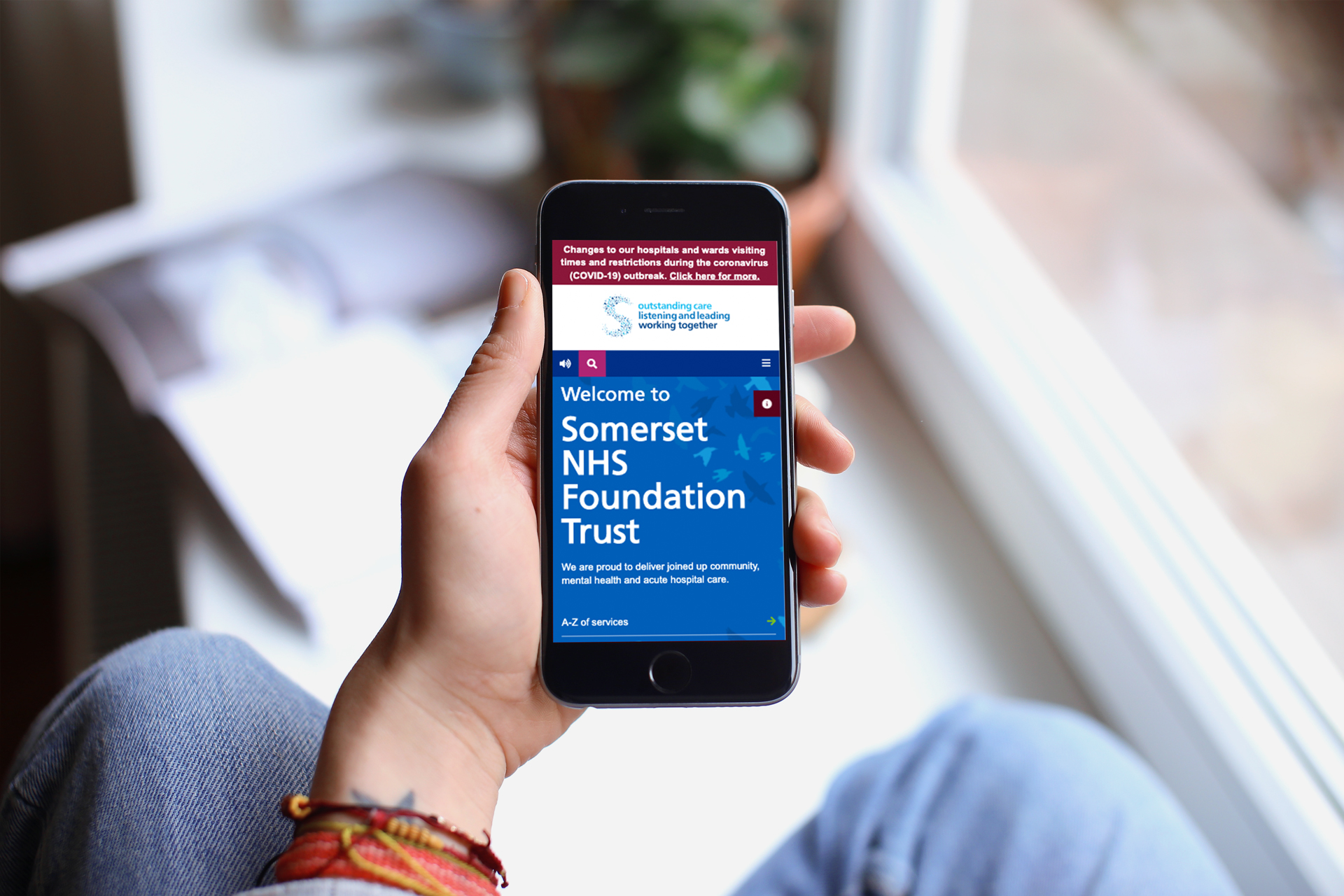 Person visiting NHS Trust site on smartphone